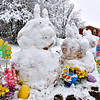 (Brad Davis/The Register-Herald) A trio of snow bunnies constructed in the backyard of a Temple Street residence wishes passerbys a happy Spring, a very cold and snowy one, following another round of harsh weather Saturday.