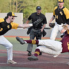 (Brad Davis/The Register-Herald) West Liberty infielder Tyler Ramsay, left, reaches to tag out University of Charleston baserunner Hayden Cartt (#33), who goes airborne trying to avoid it, after getting caught in a rundown between the plate and 3rd during Mountain East Tournament action Friday evevning at Linda K. Epling Stadium.