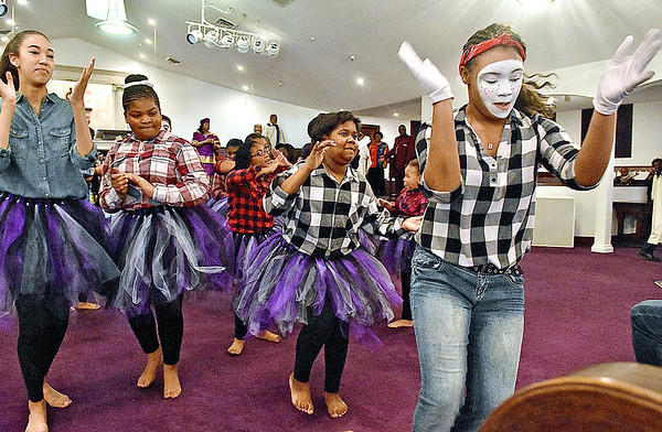 (Brad Davis/The Register-Herald) Young church members showcase their talents as they perform a Liturgical Dance as part of Heart of God Ministries' annual Black History Celebration Sunday afternoon at their Kanawha Street location.