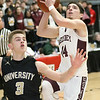 (Brad Davis/The Register-Herald) Woodrow Wilson's Bryce Radford drives to the basket as University's Kaden Metheny defends during Big Atlantic Classic action Saturday the Beckley-Raleigh County Convention Center.