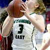 (Brad Davis/The Register-Herald) Wyoming East's Kara Sandy drives and scores as Wayne's Aerial Adkins defends Friday morning at the Charleston Civic Center.