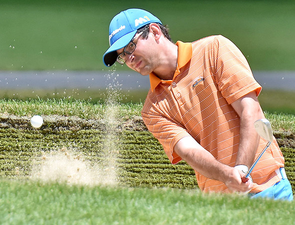 (Brad Davis/The Register-Herald) Alasdair Forsythe chips from a bunker onto the #16 green during third round action at the West Virginia Amateur Wednesday afternoon on the Greenbrier's Meadows Course.