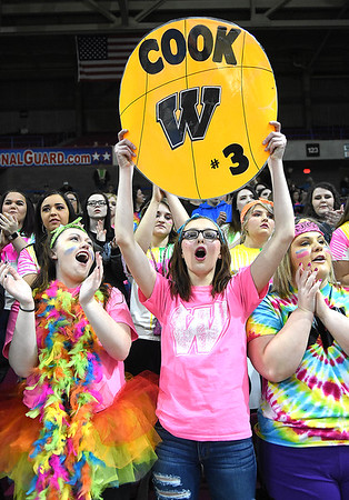 Ally Cassell, left, Carla Cook and Abby Brown, Westside students, cheer for their team against Winfield Wednesday morning during the quarter-final game of the Class AA Boys State Basketball Tournament held at the Charleston Civic Center. Winfield won 68-65<br /> (Rick Barbero/The Register-Herald)