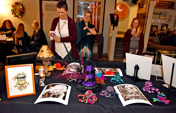 (Brad Davis/The Register-Herald) Art enthusiasts browse a variety of works by area artisans during Treehouse Arts' Dark Arts Show Friday evening at Brown Dog Bottom in the Underground.