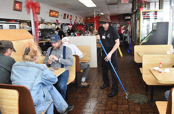 Jeff Thomas mops up the floor at the Omelette Shop on Harper Road in Beckley Christmas day.<br /> (Rick Barbero/The Register-Herald)