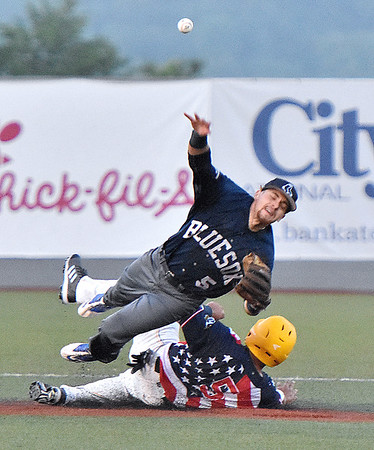 (Brad Davis/The Register-Herald) Miners baserunner Jonathan Pasillas is forced out at 2nd but manages to disrupt the double play attempt with a takeout slide on Butler shortstop Damian Maglione Saturday night at Linda K. Epling Stadium.