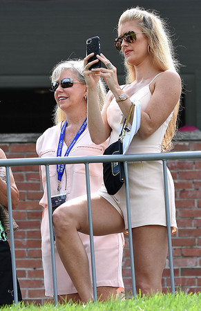 Connie Bair, of Charleston, left and her daughter Heather, of New York, watching Bubba Watson's group on the par 3, 18th green during the first round of, A Military Tribute at The Greenbrier golf tournament.<br /> (Rick Barbero/The Register-Herald)