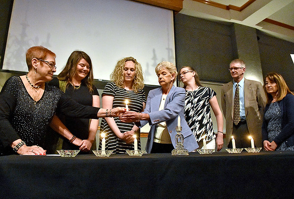 (Brad Davis/The Register-Herald) Members of Temple Beth El light six candles, each representing one of six million Jews murdered during the holocaust at the conclusion of this year's Yom HaShoah ceremony held every year in Beckley Sunday afternoon inside WVU Tech's Carter Hall.