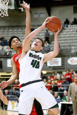 (Brad Davis/The Register-Herald) Wyoming East's Jacob Bishop drives to the basket with the game tied in the final seconds but would have the attempt blocked by Greater Beckley Christian defender Jay Moore to preserve overtime, where the Crusaders would earn a win in the Little General Battle for the Armory consolation game Saturday night at Beckley-Raleigh County Convention Center.