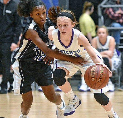 (Brad Davis/The Register-Herald) Eastern Greenbrier's Allie Dunford holds off Beckley-Stratton's Lataja Creasey as she moves the ball up the court during the Middle School Girl's championship game at the Big Atlantic Classic Wednesday afternoon at the Beckley-Raleigh County Convention Center.
