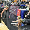 (Brad Davis/The Register-Herald) Wyoming East's Jazz Blankenship comes over to the bench to see what point guard-turned-coach Gabby Lupardus is seeing from North Marion during a brief pause in the action Saturday afternoon at the Charleston Civic Center.