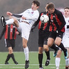 George Washington's Matthew Vaughn (7) and University's Mason Shockley (4) vie for possession during the first half of their  Class AAA boys semifinal game in Beckley. (Chris Jackson/The Register-Herald)