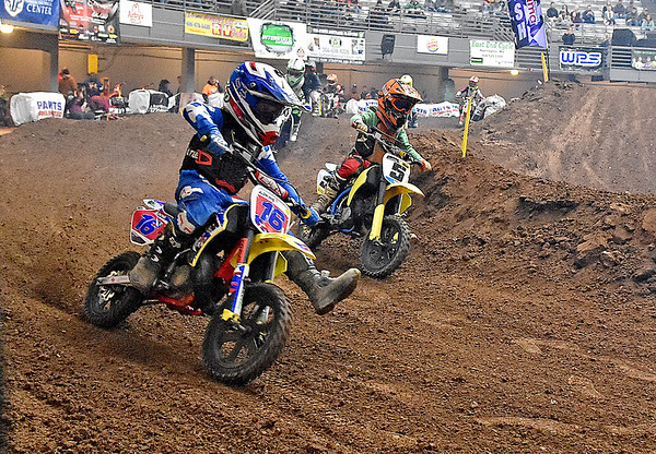 (Brad Davis/The Register-Herald) Scenes from the weekend's Tristate MX dirt bike racing event Saturday night at the Beckley-Raleigh County Convention Center.