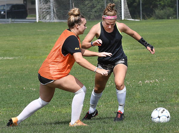 Woodrow Wilson Emily Crook, left and Logan Ragland practicing at the YMCA Paul Cline Memorial Youth Sports Complex Wednesday morning.<br /> (Rick Barbero/The Register-Herald)