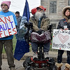 (Brad Davis/The Register-Herald) Demonstrators look on as speakers deliver their messages during Beckley's March For Our Lives rally Saturday afternoon at Shoemaker Square.