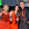 (Brad Davis/The Register-Herald) Deb Evans and Noah Kapp accept trophies for 2nd Place Judges Choice with choreographer Hilary Jereza during the United Way of Southern West Virginia's Dancing With the Stars fundraising event Friday night at the Beckley-Raleigh County Convention Center.
