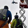 (Brad Davis/The Register-Herald) Fellow B.A.S.E. jumpers marvel from the regular jumping platform as some choose to leap from a fully raised scissor lift during Bridge Day Saturday morning in Fayetteville.