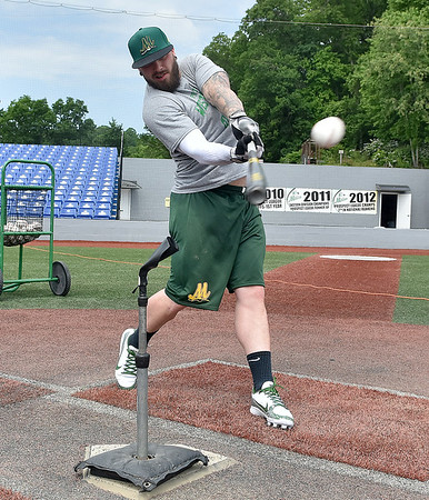 (Brad Davis/The Register-Herald) Incoming Miners 1st baseman Kendrick Epling, son of manager Tim, works on his swing as he takes cuts off a tee during some down time at Linda K. Epling Stadium Friday afternoon.