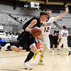 Valley's Adam Falbo (10) drives the baseline past Van's Taylor Jarrell (12) during their Big Atlantic Classic Tournament Monday in Beckley. Valley won 69-59 win. (Chris Jackson/The Register-Herald)
