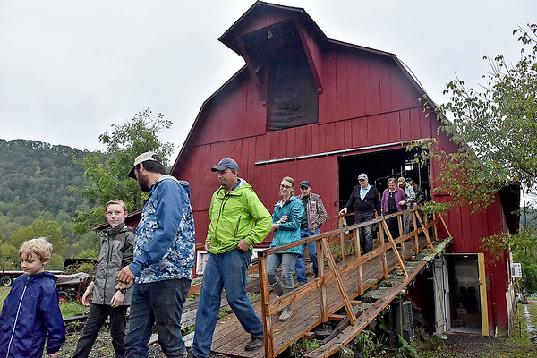 (Brad Davis/The Register-Herald) A large group of visitors embark from the main barn area out into the fields of Sprouting Farms as they begin a tour of the grounds during a WV CRAFT (Collaborative Regional Alliance for Farmer Training) open house style event Sunday afternoon in Talcott.