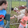 (Brad Davis/The Register-Herald) McKalah Martin from Old Mill Farms introduces 6-year-old Madison Yonts to a pair of small goats on hand along with a Llama, two mini horses and several other furry friends she brought with her to Founder's Day Saturday afternoon at Wildwood House.