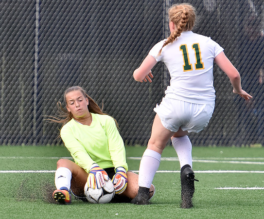 (Brad Davis/The Register-Herald) Woodrow Wilson goalkeeper Jordan Lilly comes out of her net to thwart a scoring opportunity for Greenbrier East's Kate Perkins Friday evening at the YMCA Paul Cline Memorial Soccer Complex.