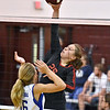 (Brad Davis/The Register-Herald) PikeView's Makenzee Shrewsbury spikes the ball past Capital's Kayla Moffatt during Shirley Brown Invitational action Saturday morning at Woodrow Wilson High School.