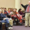 (Brad Davis/The Register-Herald) Teacher John Quesenberry comments on concerns over PEIA during a public hearing Wednesday night at Tamarack.