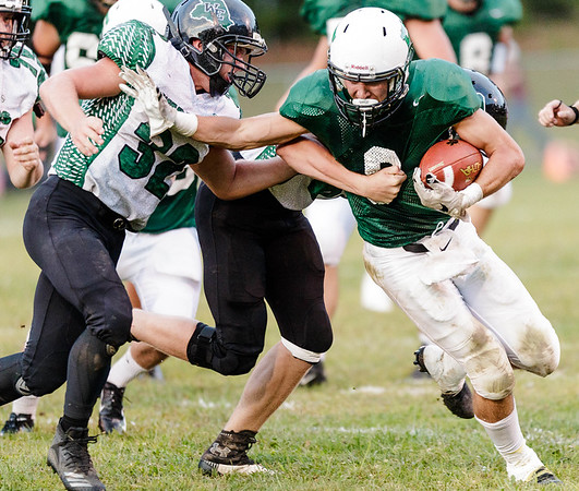 Jordan Dempsey of Fayetteville tries to get around Wyoming East's Michael Elkins, but is wrapped up from behind. Chad Foreman for the Register-Herlad.