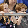 Rylee Rutherford, 4, and Tristan Stover, 4, from Shady Spring, watch the pre-game ceremonies during their high school football game between Shady Spring and Wyoming East Friday in Shady Spring. (Chris Jackson/The Register-Herald)