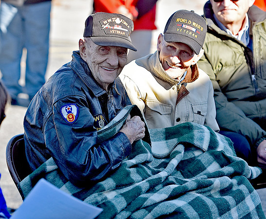 (Brad Davis/The Register-Herald) Veterans Herbert Lindsey (WWII, Korea), left, and Harold Stone (WWII) smile towards the crowd as they're acknowledged during the 5th Annual Healing Fields Ceremony Sunday at the Raleigh County Veterans Museum.