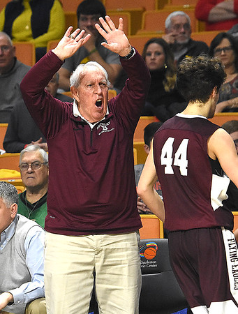 Woodrow Wilson asst. coach Dave Barksdale reacts to an officials call during game against Martinsburg in the quarter-final game of the Class AAA Boys State Basketball Tournament held at the Charleston Civic Center. Martingburg won 58-48<br /> (Rick Barbero/The Register-Herald)