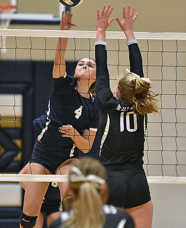 (Brad Davis/The Register-Herald) Shady Spring's Rylee Wiseman spikes the ball as James Monroe's Gracie Mann defends Thursday night in Shady Spring.