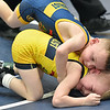 (Brad Davis/The Register-Herald) North Marion's Jackson Ely, top, takes on Lead Dog Wrestling's Aiden Belcher in a 45-pound weight class matchup Sunday afternoon at Beckley-Raleigh County Convention Center. Ely won the match.