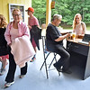 "(Brad Davis/The Register-Herald) Pink-clad theater goers make their way inside the Cliffside Amphitheatre prior to the last performance of Theatre West Virginia's Hatfields & McCoys Sunday evening in Grandview. Anyone wearing pink, a gesture honoring actress Rhayne Thomas on her 7th year of being cancer free, got their tickets for free. Thomas has played ""Spirit McCoy"" for several years."