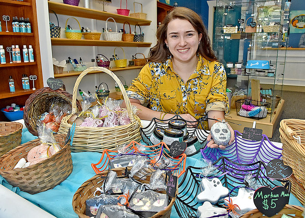 (Brad Davis/The Register-Herald) Young owner Piper Burgess shows off some of her seasonal products as she poses for a quick photo inside Bath Bliss, located at 1320 South Eisenhower Drive between Vapor Vault and Brickhouse Cardio, Thursday afternoon. She makes all of her own products, including everything seen here.