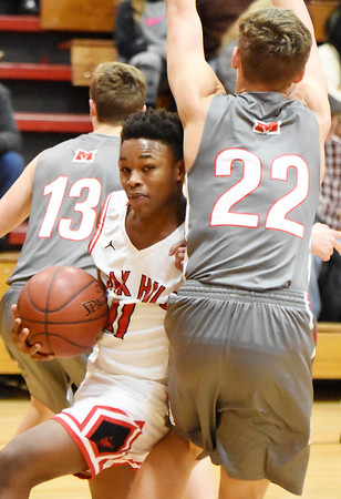 Oak Hill's Jason Manns (11) drives past Cabell Midland's Jake Edwards (22) during the first quarter of their high school basketball game Tuesday in Oak Hill. (Chris Jackson/The Register-Herald)