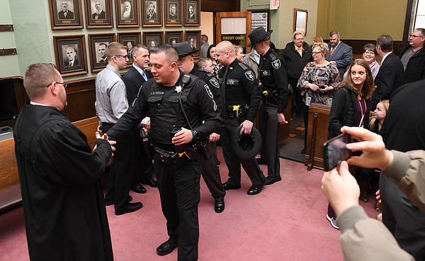 Thomas H. Ewing, left, gets greeted by guest after he was sworn in as the new Fayette County judge appointed by Governor Jim Justice, Ewing replaced John W Hatcher Jr. who recently retired. <br /> (Rick Barbero/The Register-Herald)