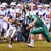 Midland Trail's Morgan Ferris (10) is tackled by Fayetteville's Logan Frantz (10) during their high school football game Friday in Fayetteville. (Chris Jackson/The Register-Herald)