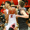 (Brad Davis/The Register-Herald) Oak Hill's Michael Beasley drives to the basket as Westside's Corey Hatfield defends Friday night in Oak Hill.