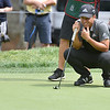 (Brad Davis/The Register-Herald) Defending champ Xander Schauffele eyeballs his next putt on 11 during the second round of the Military Tribute at The Greenbrier Thursday afternoon in White Sulphur Springs.