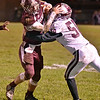 (Brad Davis/The Register-Herald) Woodrow Wilson's Logan Cook carries the ball as George Washington's D'onte Johnson tries to tackle him Friday night in Beckley.