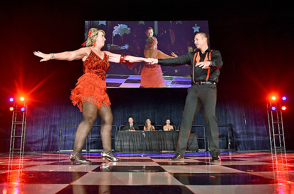 (Brad Davis/The Register-Herald) Dancers Deb Evans and Noah Kapp perform during the United Way of Southern West Virginia's Dancing With the Stars fundraising event Friday night at the Beckley-Raleigh County Convention Center.