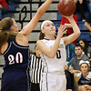 (Brad Davis/The Register-Herald) Nicholas County's Kristen Woods drives and scores as Independence's Hannah Adams defends Friday night in Summersville.