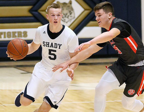 (Brad Davis/The Register-Herald) Shady Spring's Stephen Williams holds off Poca defender Ethan Payne as he rushes up the court Wednesday night inside the Tigers' brand new gym.