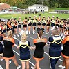 Cheerleaders from Greenbrier West and Summers Co. join hands in prayer before game at Greenbrier West High School in Charmco Friday night.<br /> Rick Barbero/The Register-Herald)