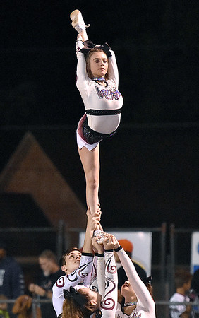(Brad Davis/The Register-Herald) A Woodrow Wilson cheerleader makes it look easy as she pulls off a stunt Friday night in Beckley.
