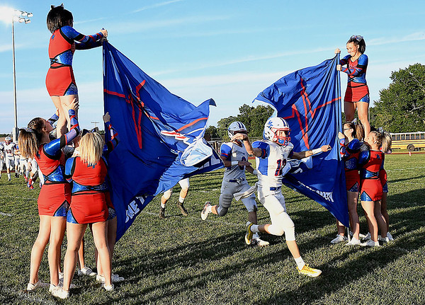 Austin Isaacs, of Midland trail bust through the school banner to kick off the first week of High School football againt Independence Friday night at Independence High School.<br /> Rick Barbero/The Register-Herald)