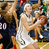 (Brad Davis/The Register-Herald) Nicholas County's Anna Hamilton drives to the basket as Independence's Hannah Adams defends Friday night in Summersville.