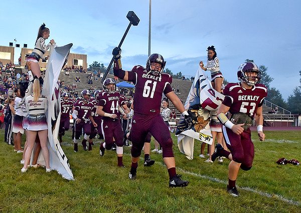 (Brad Davis/The Register-Herald) The Flying Eagles take the field for visiting opponent Parkersburg Friday night in Beckley.